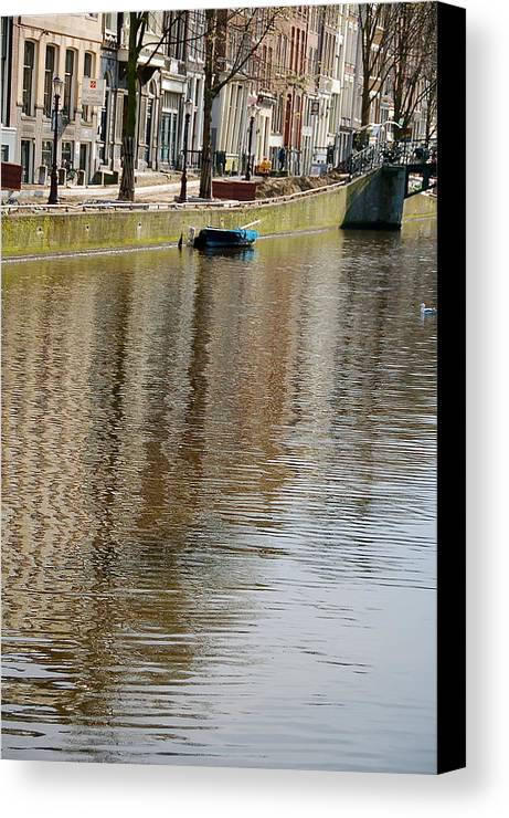Wateer Canal Amsterdam Boat Builing Reflection Canvas Print featuring the photograph Amsterdam by Lucrecia Cuervo