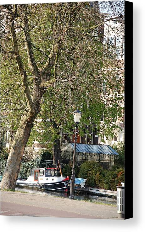 Boat Tree Canal Water Houses Light Post Canvas Print featuring the photograph Amsterdam Scenery by Lucrecia Cuervo