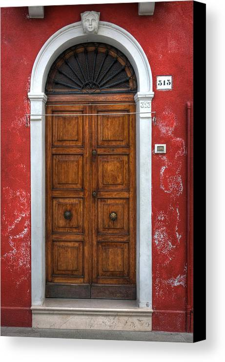 Door Canvas Print featuring the photograph an old wooden door in Italy by Joana Kruse
