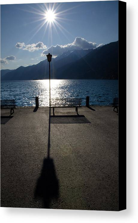 Bench Canvas Print featuring the photograph Bench And Street Lamp by Mats Silvan