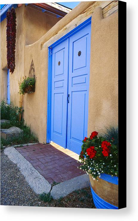 Adobe Canvas Print featuring the photograph Blue Door Of An Adobe Building Taos New Mexico by George Oze