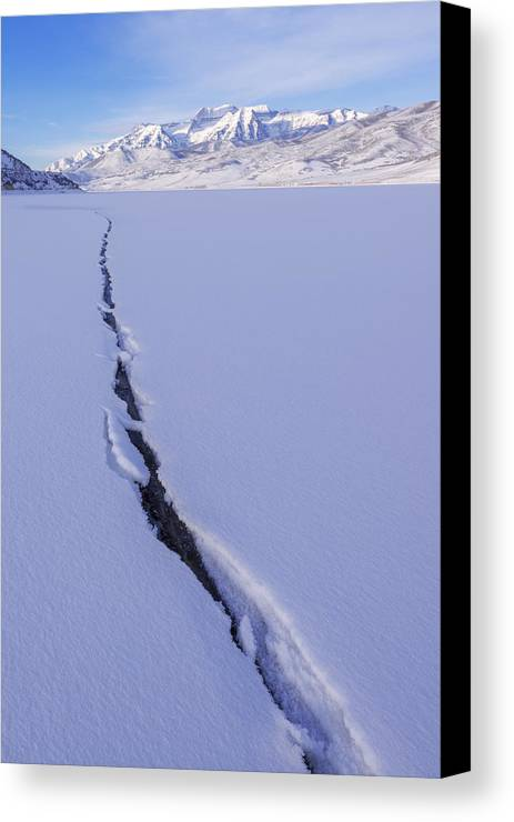 Breaking Ice Canvas Print featuring the photograph Breaking Ice by Chad Dutson