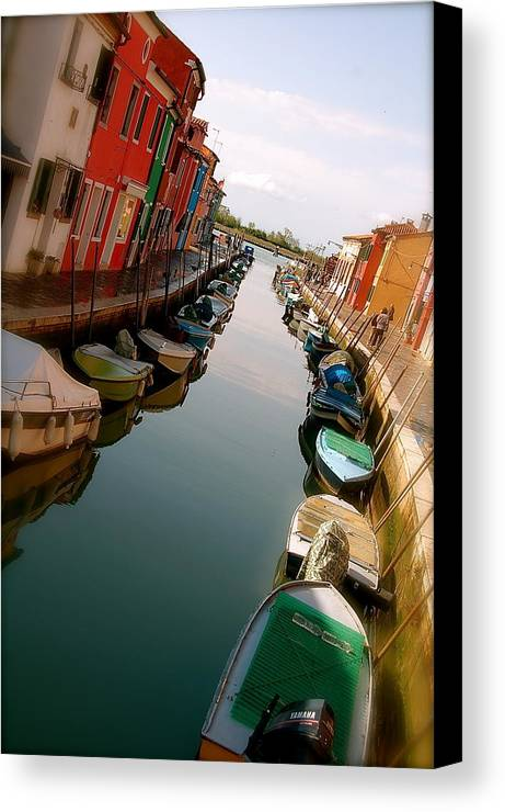 Canal Painted Houses Boat Water Canvas Print featuring the photograph Burano Canal by Lucrecia Cuervo