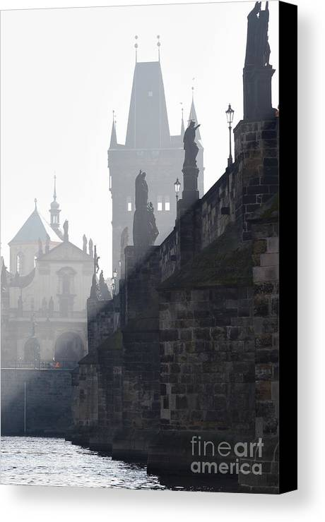 Bridge Canvas Print featuring the photograph Charles Bridge In The Early Morning Fog by Michal Boubin