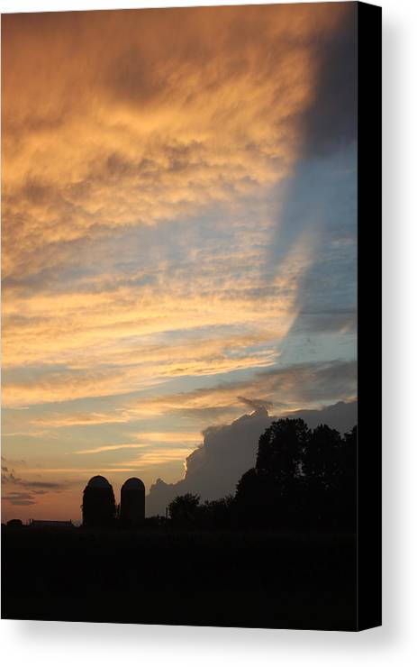 Clouds Canvas Print featuring the photograph Clouds And Silos by Mauverneen Blevins