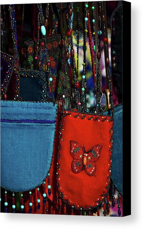 Shop Canvas Print featuring the photograph Colorful Hanging Pouches by Stuart Litoff