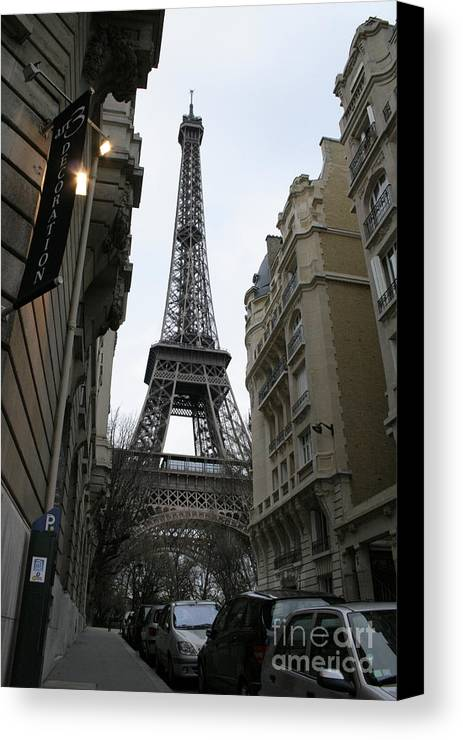 Eiffel Tower Canvas Print featuring the photograph Eiffel Tower Through A Concrete Forest by Joshua Francia