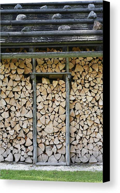Firewood Canvas Print featuring the photograph Firewood Stack by Frank Tschakert