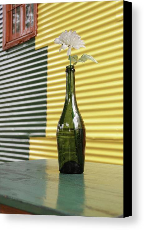 Table Canvas Print featuring the photograph Flower In A Bottle by Silvia Bruno