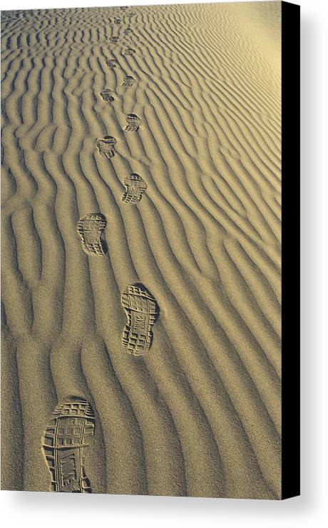 Footprints Canvas Print featuring the photograph Footprints In The Sand by Joe Palermo