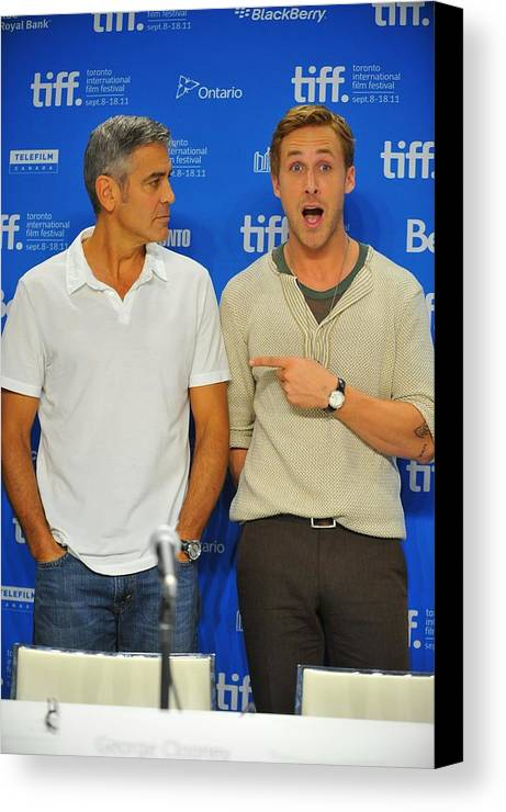 George Clooney Canvas Print featuring the photograph George Clooney, Ryan Gosling by Everett