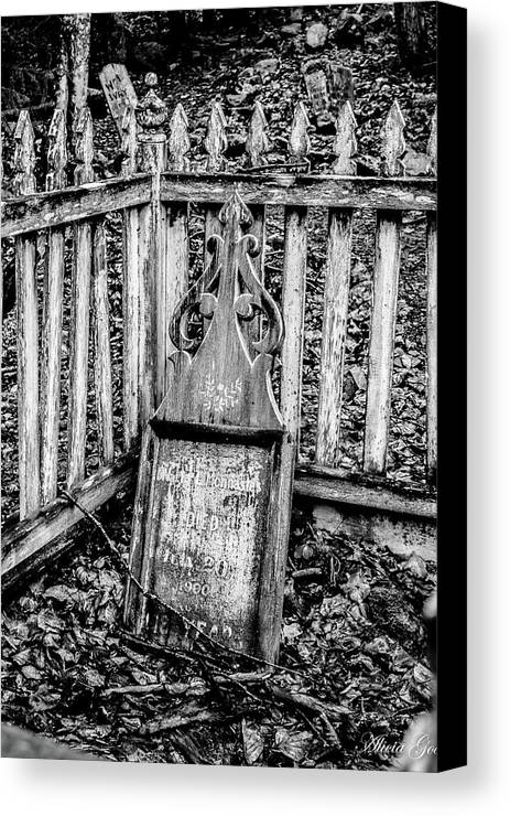 Grave Canvas Print featuring the photograph Graveyard by Alicia Goodrich