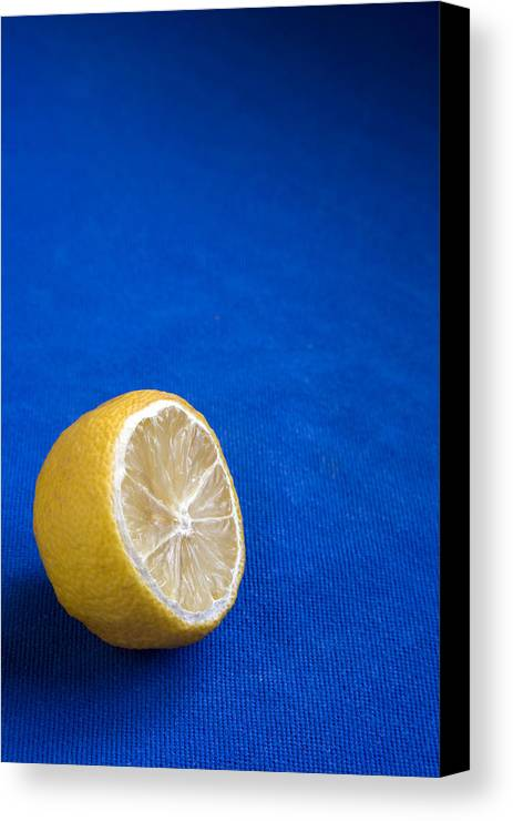 Blue Canvas Print featuring the photograph Just A Lemon by Steve Outram