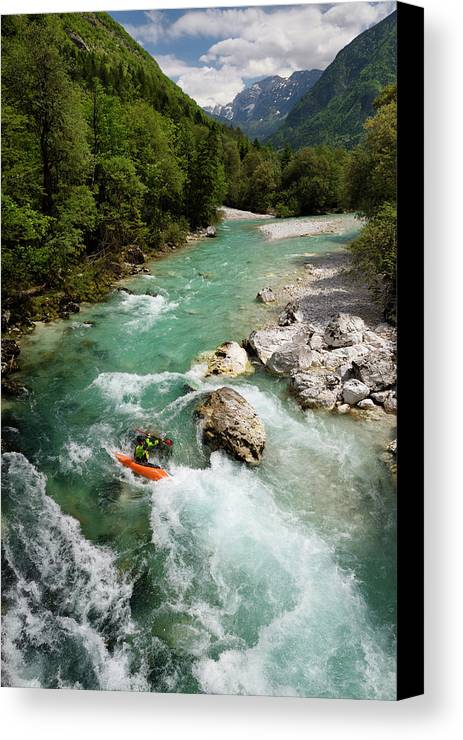 Turquoise Canvas Print featuring the photograph Kayaker Shooting The Cold Emerald Green Alpine Water Of The Uppe by Reimar Gaertner