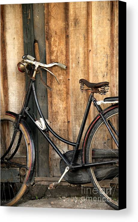 Bi-cycle Canvas Print featuring the photograph Parked by Charuhas Images