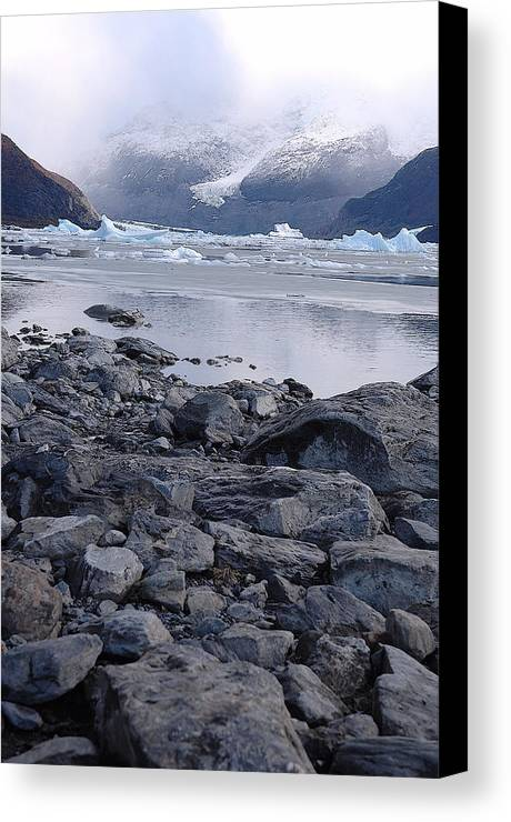 Mountain Rocks Ice Clouds Canvas Print featuring the photograph Patagonia Ice by Lucrecia Cuervo