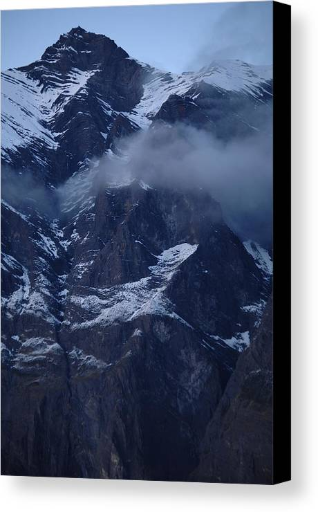 Mountain Ice Clouds Snow Canvas Print featuring the photograph Patagonia by Lucrecia Cuervo