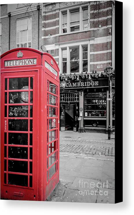 Red Canvas Print featuring the photograph Red Telephone Box by Arild Lilleboe