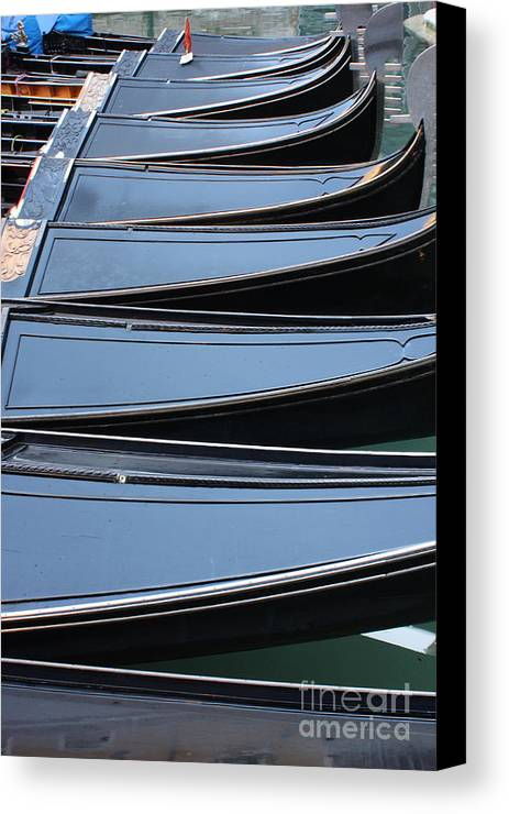 Italy Canvas Print featuring the photograph Row Of Gondolas In Venice by Michael Henderson