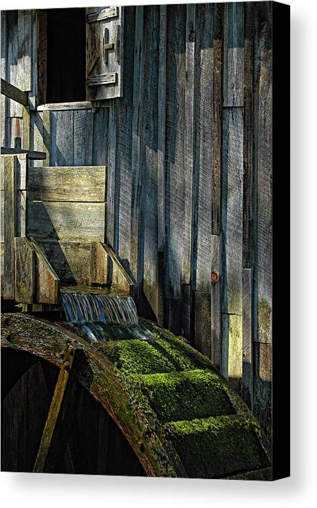 Water Canvas Print featuring the photograph Rustic Water Wheel With Moss by Mitch Spence