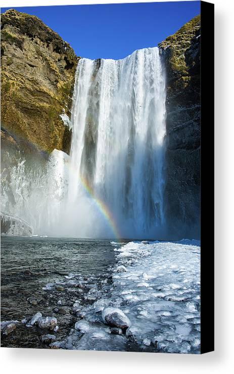 Skogafoss Canvas Print featuring the photograph Skogafoss Waterfall Iceland In Winter by Matthias Hauser