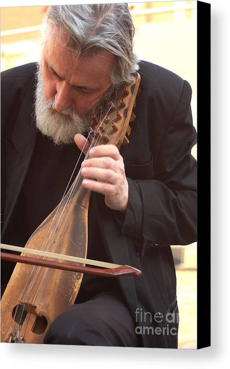 Venice Canvas Print featuring the photograph Street Musician In Venice by Michael Henderson