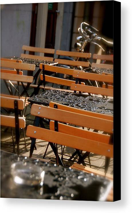 Sun Shower Table Chairs Canvas Print featuring the photograph Sun Shower by Lucrecia Cuervo