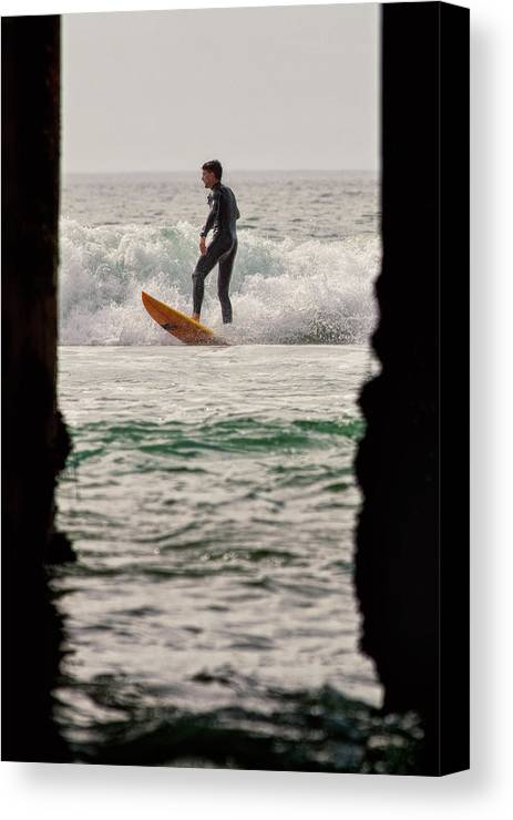 Surfing Canvas Print featuring the photograph Surfing By The Pier by Nicole Swanger