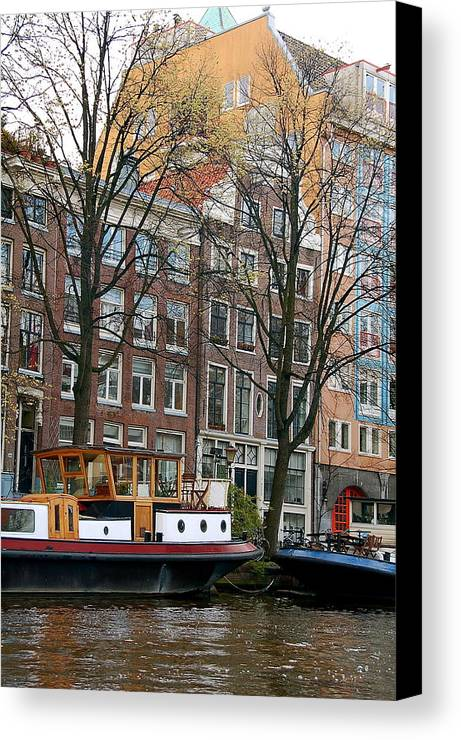 Boats Water Canal Waterway Buildings Windows Trees Colorful Canvas Print featuring the photograph Waterway by Lucrecia Cuervo