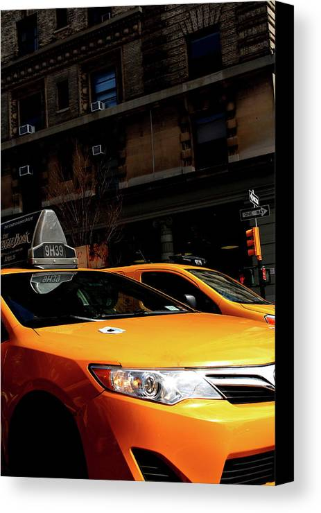 Taxi Canvas Print featuring the photograph Yellow Cab by Jerome Sauvage