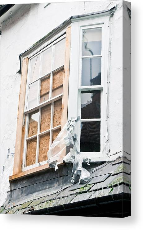 Abandoned Canvas Print featuring the photograph Boarded Up Window by Tom Gowanlock