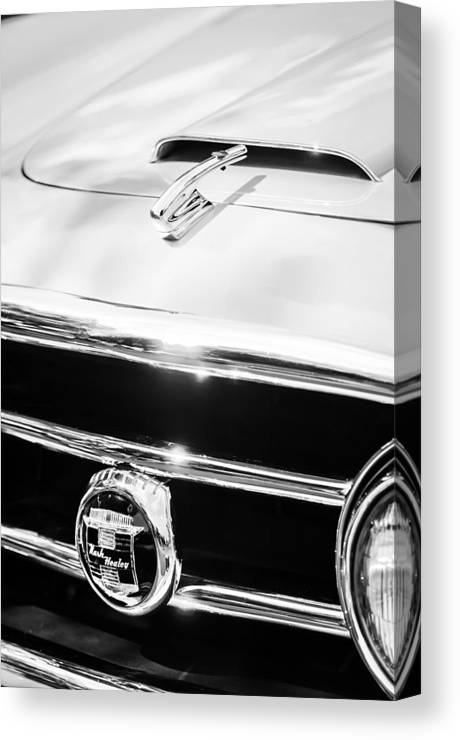 1953 Nash-healey Convertible Grille Emblem Canvas Print featuring the photograph 1953 Nash-healey Convertible Grille Emblem by Jill Reger