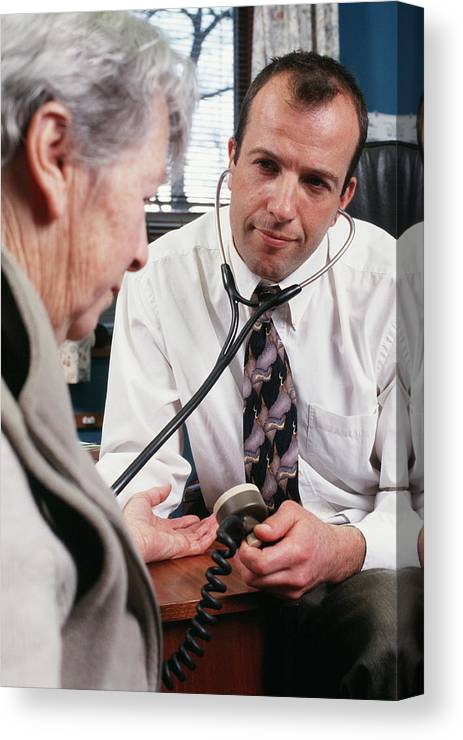 General Practice Canvas Print featuring the photograph Measuring Blood Pressure by Jim Varney/science Photo Library