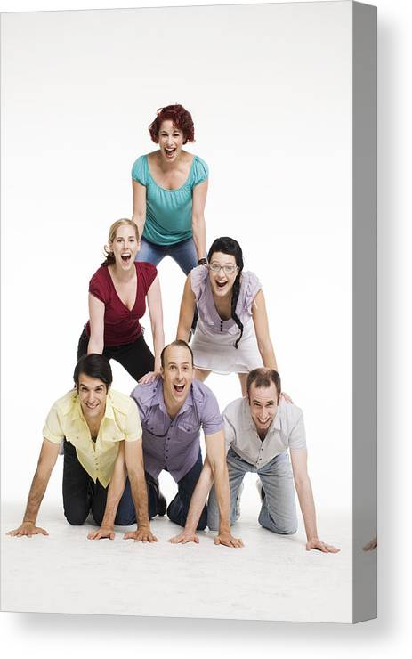 A Group Of People In A Human Pyramid Canvas Print