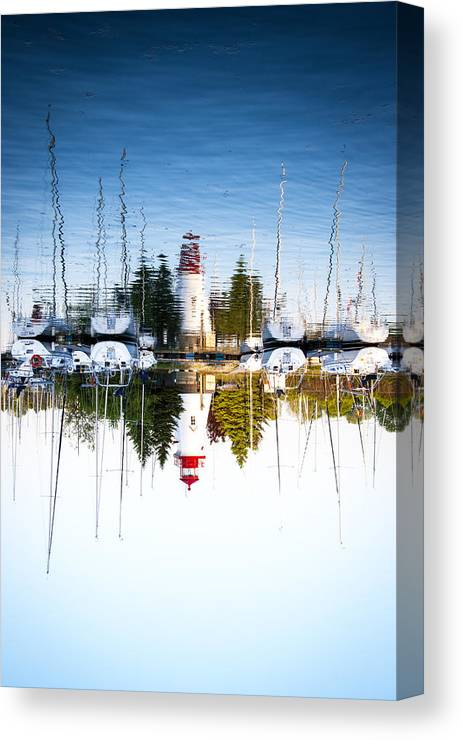 Marina Canvas Print featuring the photograph A Lighthouse by Les Lorek