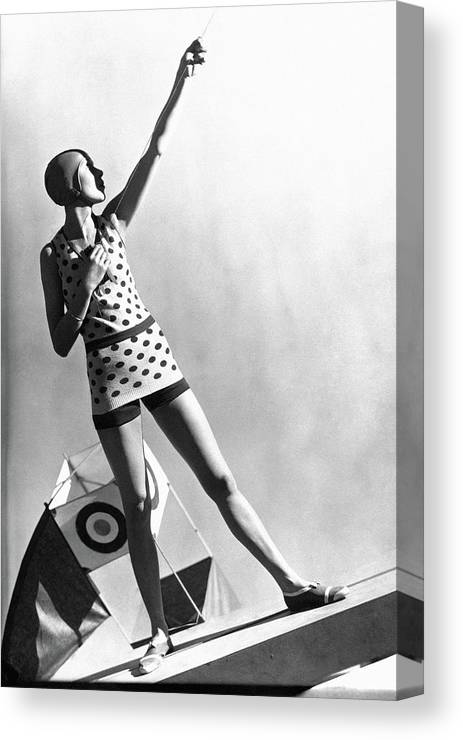 Fashion Canvas Print featuring the photograph A Model Wearing A Polka Dot Swimsuit by George Hoyningen-Huene