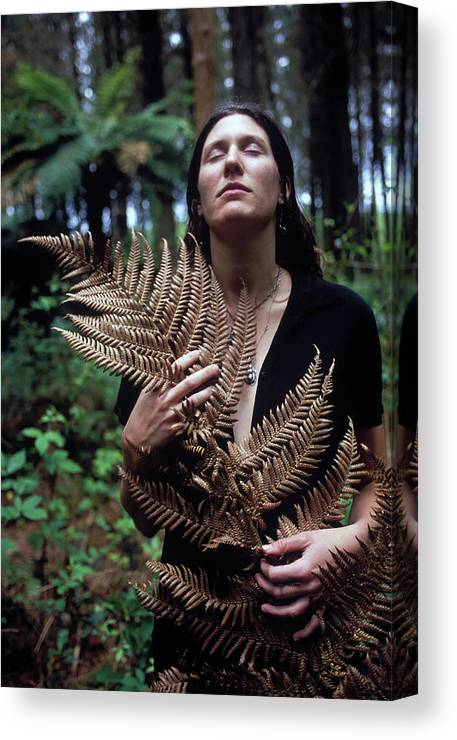 Calm Canvas Print featuring the photograph A Young Woman Cradles A Fern Frond by Kyle George