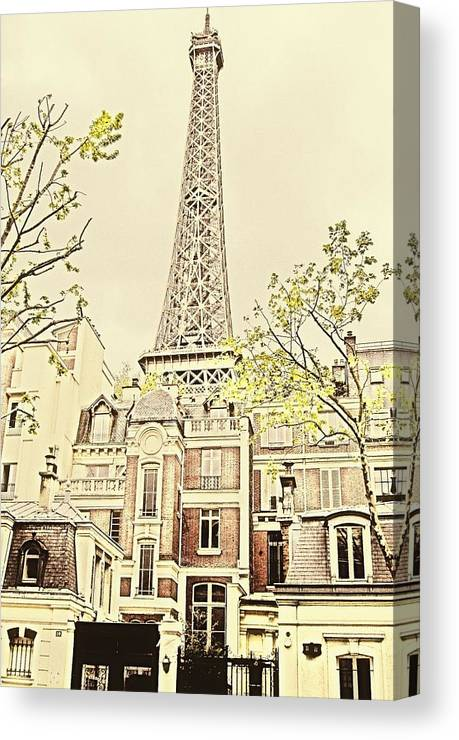 Eiffel Tower Canvas Print featuring the photograph Above The Rooftops by Jenny Hudson