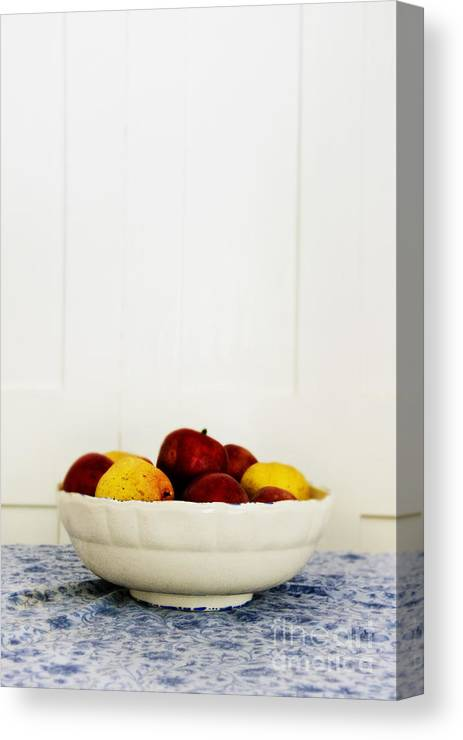 Fruit; Bowl; Still Life; Table; Table Cloth; Bowl Of Fruit; Fresh; Food; Kitchen; Old; Apples; Red; Yellow; Inside; Indoors; White; Blue; Minimal; Minimalism; Wall; Wood Canvas Print featuring the photograph Apples by Margie Hurwich