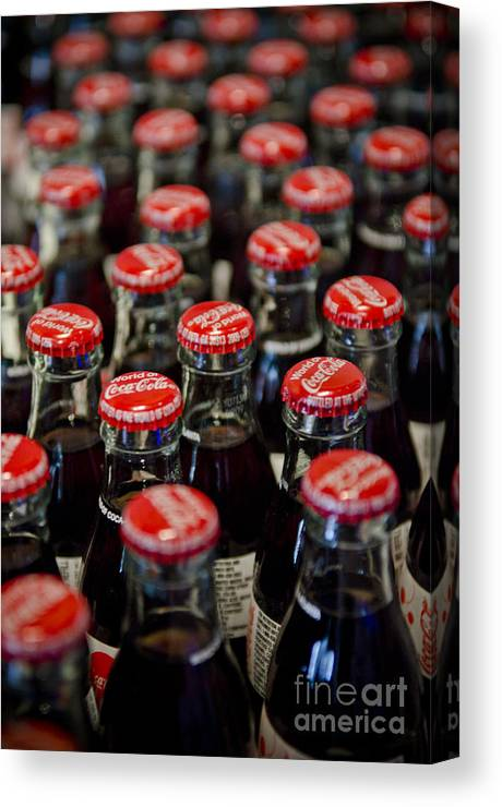 Coke Canvas Print featuring the photograph Bottle Caps by Jessica Berlin
