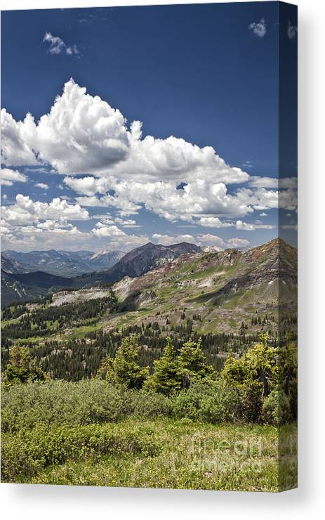 Colorado Canvas Print featuring the photograph Clouds Over Crested Butte by Timothy Hacker