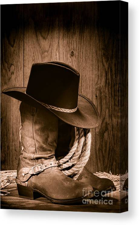 Boots Canvas Print featuring the photograph Cowboy Hat And Boots by Olivier  Le Queinec 6d9a6be27404