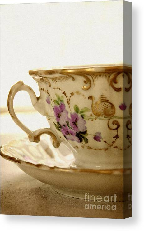 White; Beautiful; Gorgeous; Elegant; Shiny; Elegance; Teacup; High Tea; China; Porcelain; Floral Design; Prim; Proper; Dainty; Vintage; Antique; Saucer; Tea; Table; Bright; Close Up; Ornate; Gold; Floral Pattern; Pink; Purple Canvas Print featuring the photograph Floral Tea by Margie Hurwich