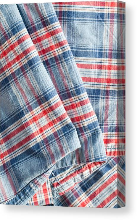 Apparel Canvas Print featuring the photograph Folded Fabric by Tom Gowanlock