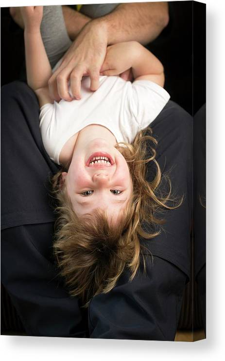 Day Canvas Print featuring the photograph Girl Being Tickled by Aberration Films Ltd