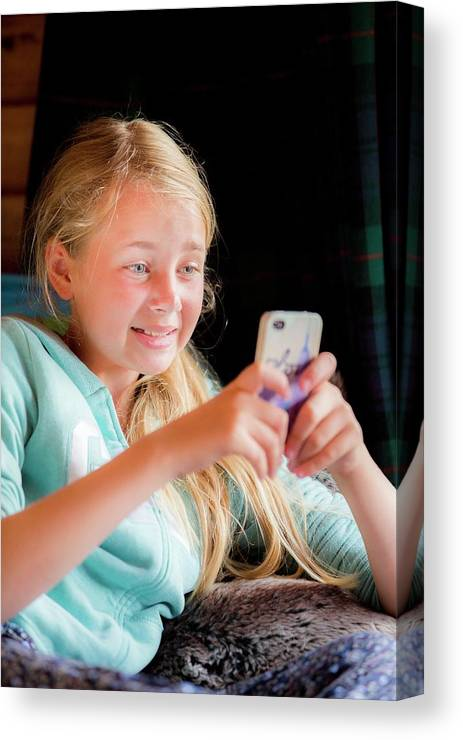 Indoors Canvas Print featuring the photograph Girl Using A Smartphone by Samuel Ashfield