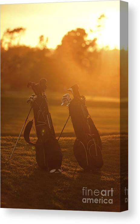 Golf Canvas Print featuring the photograph Golf Bags At Sunset by Diane Diederich