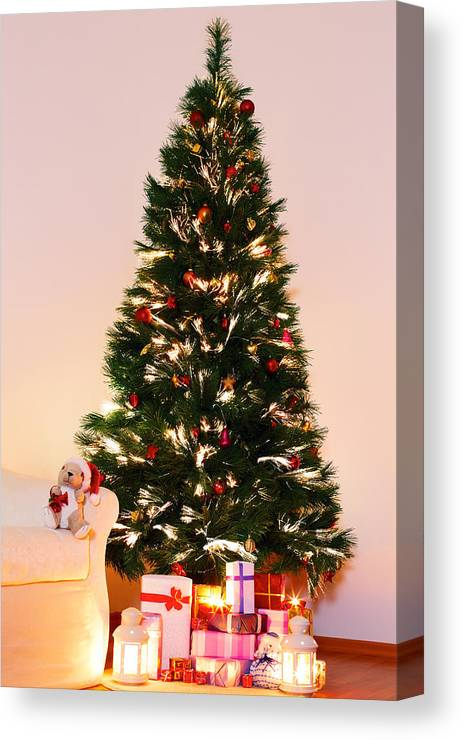 Lighted Christmas Tree With Presents Underneath In Living Room