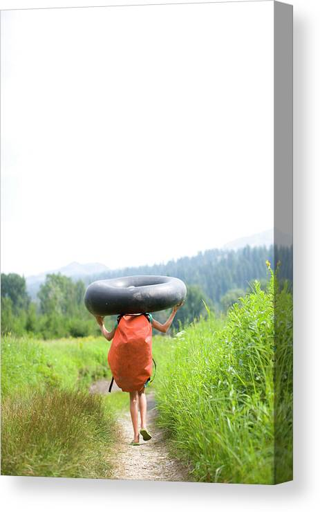 Anticipation Canvas Print featuring the photograph Pre Teen Girl Carrying  An Inner Tube by Woods Wheatcroft