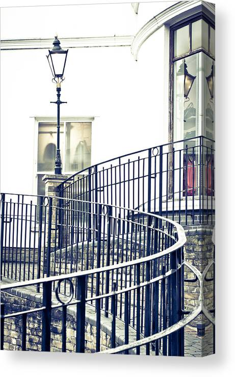 Alley Canvas Print featuring the photograph Railings And Lamp by Tom Gowanlock
